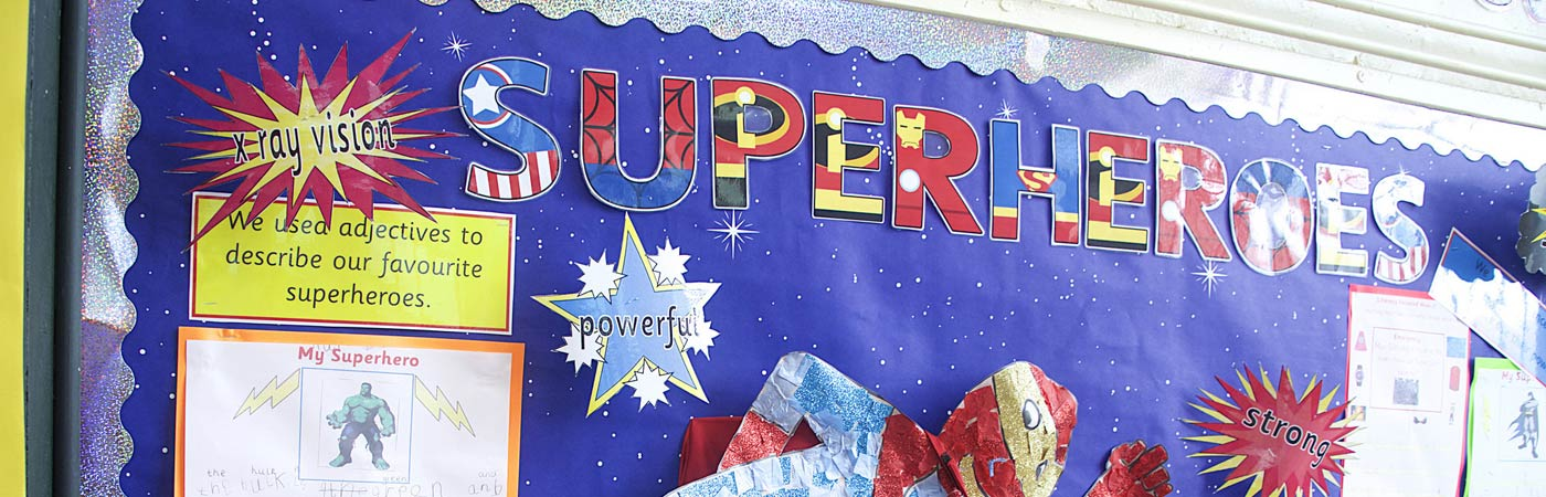 Primary school art display of superheroes