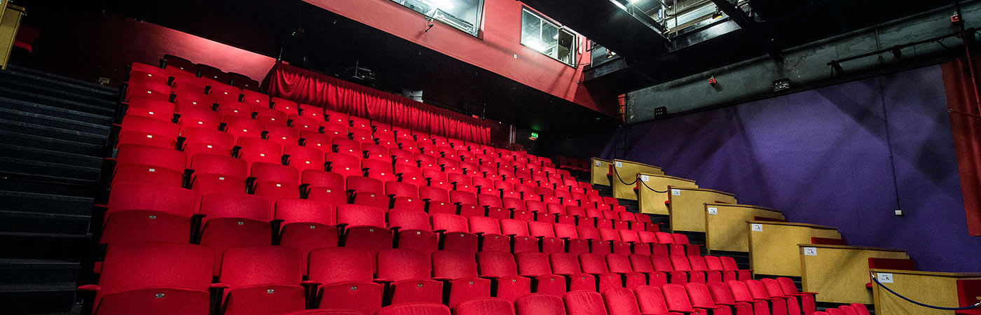 Red chairs in a theatre