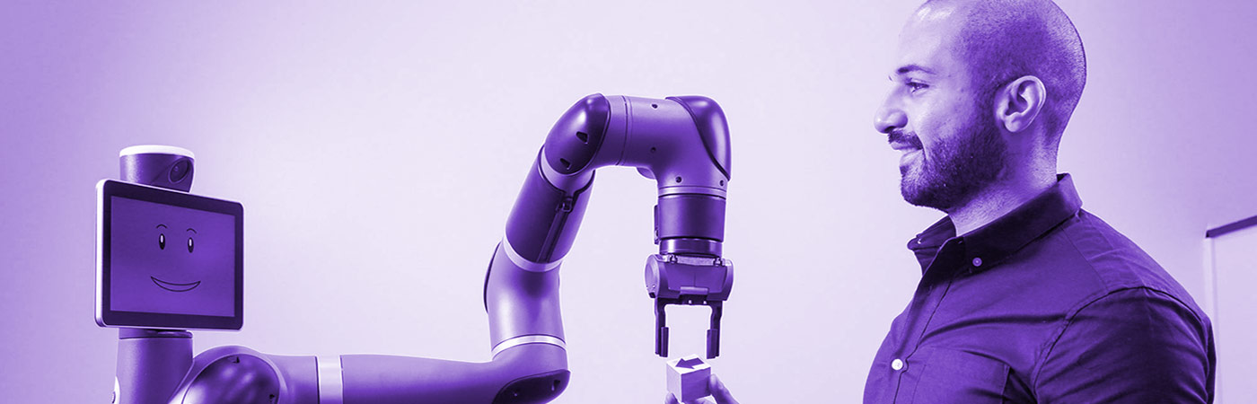 Student interacts with robot arm