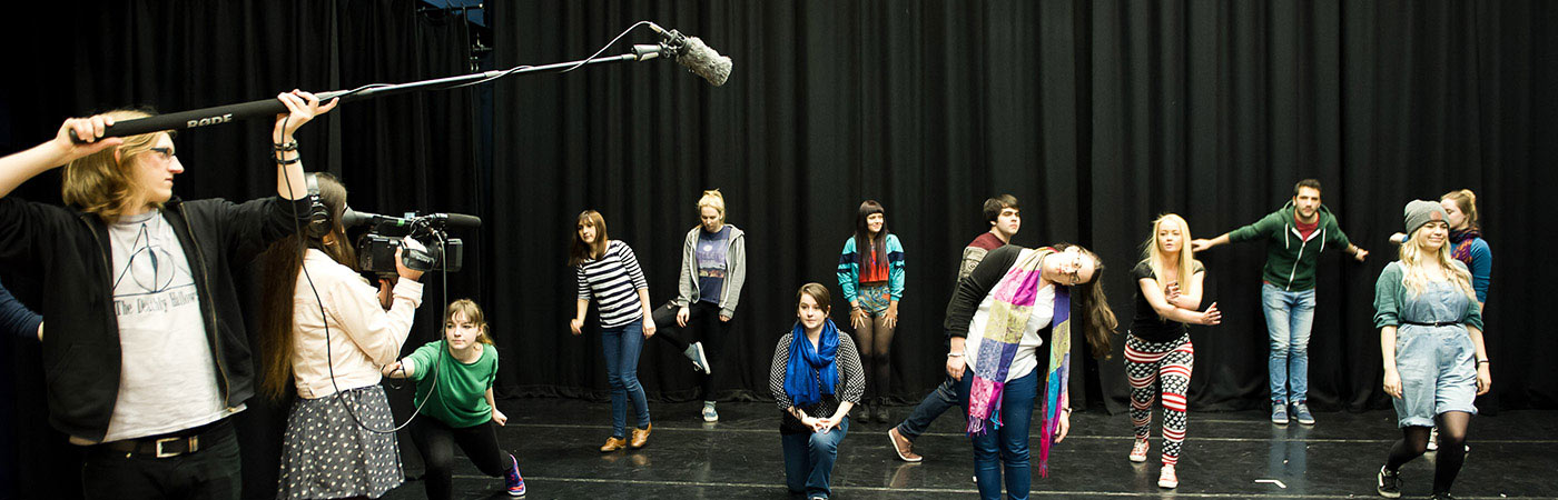 Students on stage being filmed