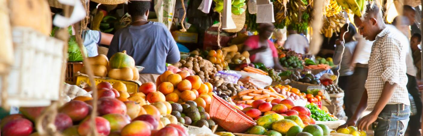 Shopper at a fruit market in the developing world.