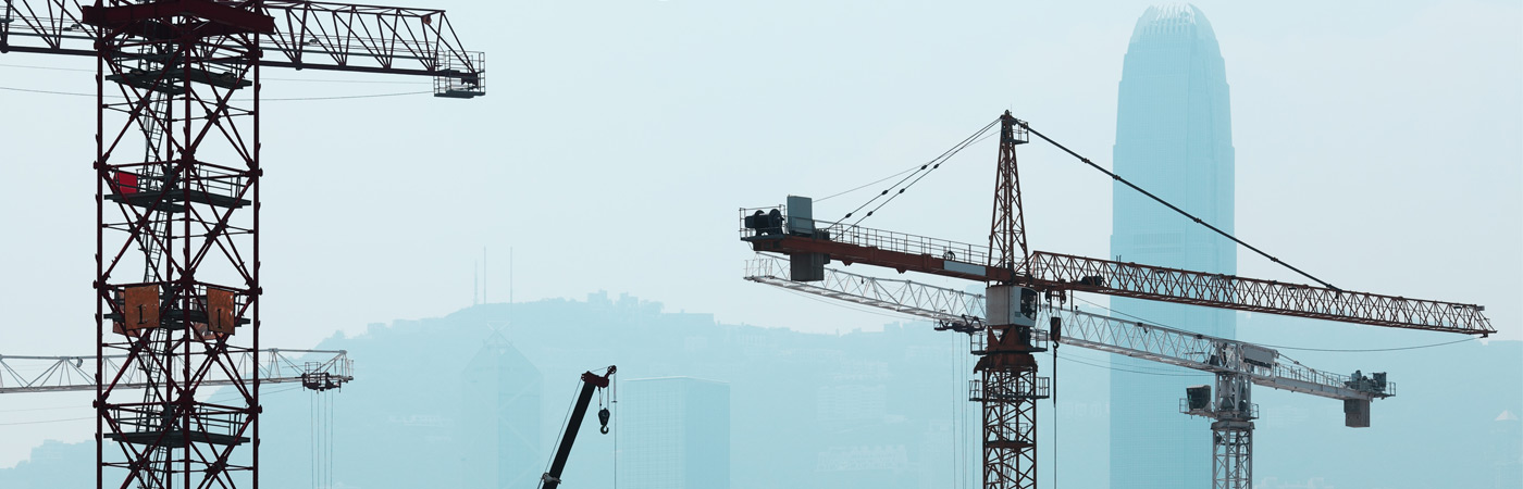 Hong Kong skyline with cranes