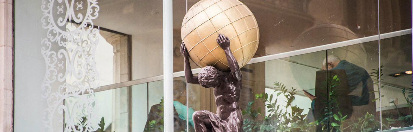 Statue of Atlas holding the world on his shoulders