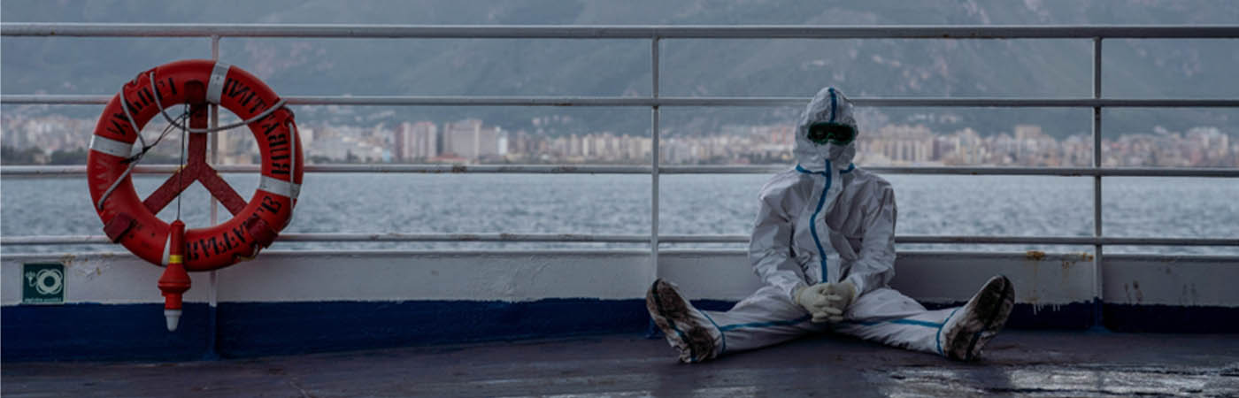 Humanitarian worker on deck of ship