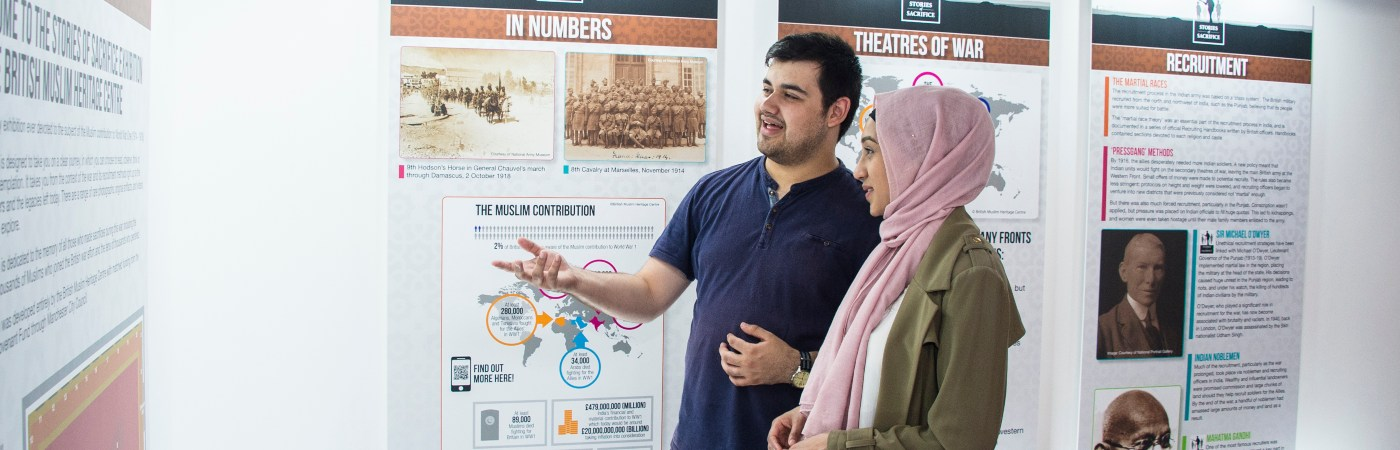 Two students reading an exhibition about Muslims' Contribution to WWI